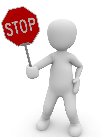 A guy holding a Stop sign