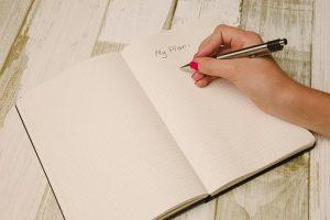 A woman writing a plan