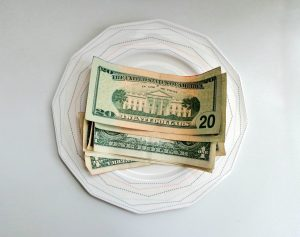 a photo of several 20 dollar bills on a plate