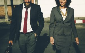A man and a woman in business suits.