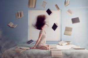 Woman throwing books in the air