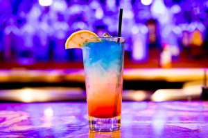 Blue and red cocktail in a nightclub.