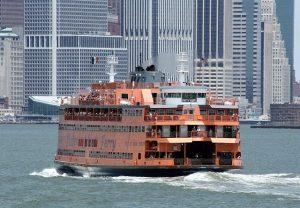 Staten Island Ferry with Manhattan skyscrapers in background.