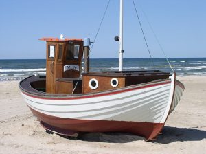 A fishing boat on the beach.