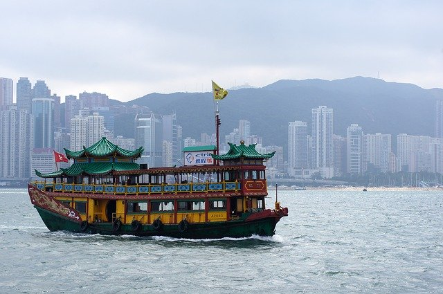 A Chinese boat near a harbor, representing a move to Hong Kong.