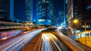 A blurred image of a Hong Kong freeway.