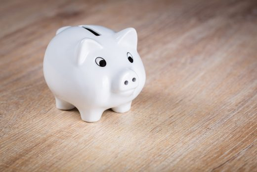A white piggy bank you need to save some money when it is necessary to organize your cross country move on a budget.
