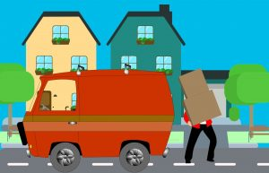 A man loading items on a truck, something you can avoid when hiring student movers.