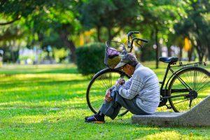 An elderly man in a park.