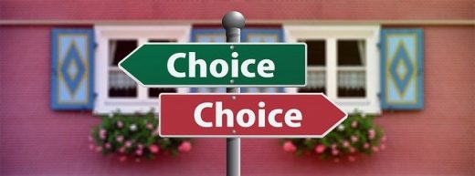 Two road signs saying choice but showing in opposite directions