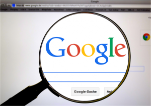 A view of Google search engine through a magnifying glass.