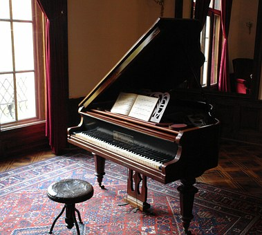 Learn how to move heavy items, such as the piano on the picture