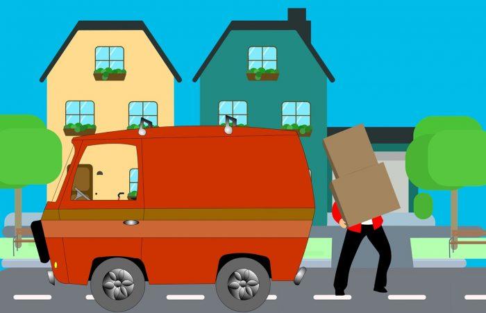 A man carrying a box next to a van.