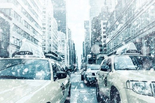 A street in New York covered in snow , which makes it clearly visible how moving your office during winter is challenging.