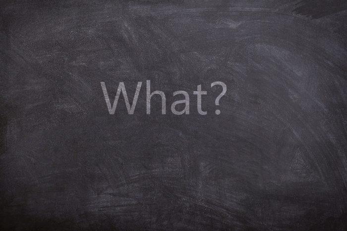 The question what written on a blackboard.