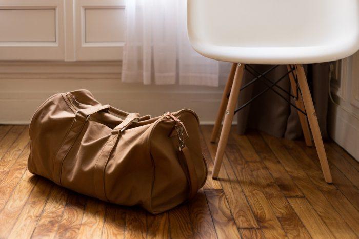 A bag next to a chair.