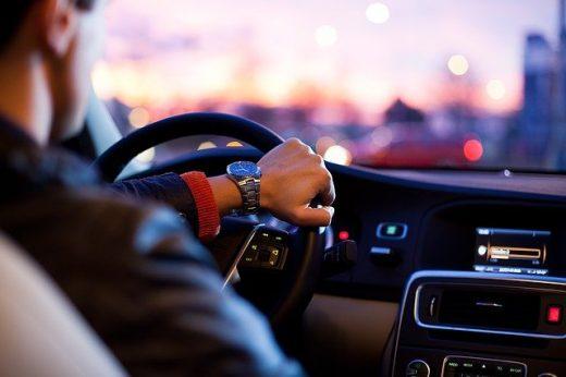 A man driving a car.