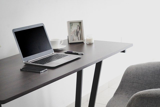 A lap top on a desk.