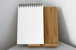 A notebook to make a list of people you want to invite when throwing your virtual housewarming party.