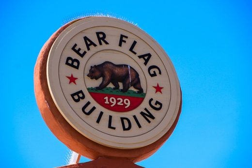 A sign for the bear flag building