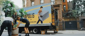 Movers loading items onto a moving truck.