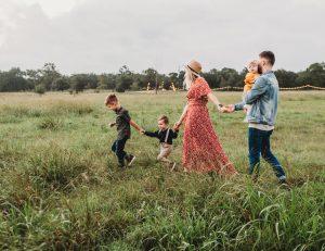 A family of five enjoying their walk.