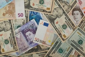 A lot of different banknotes in various currencies.