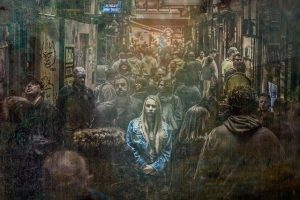 A girl, alone in a crowd.
