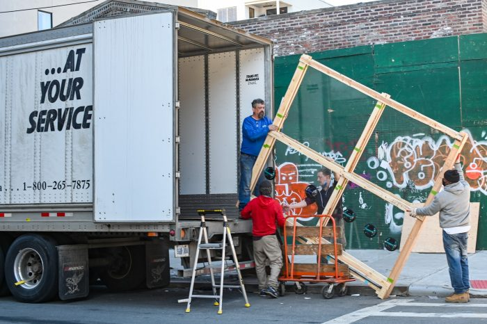 Loading a moving truck before moving to one of the affordable Florida cities
