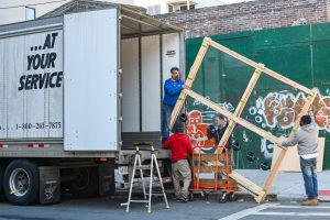 movers loading a moving truck after the process of buying a home in Charlotte comes to its end.