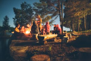 people sitting around camp fire