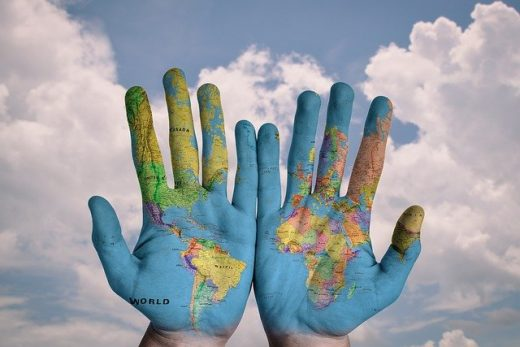 World painted on the hands
