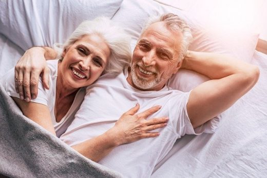 Senior couple lying in bed.